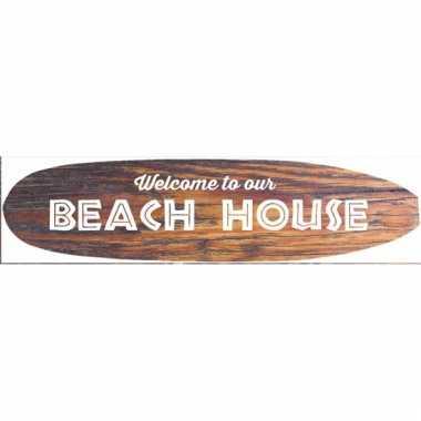 Metalen surfboard welkom