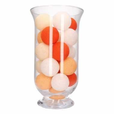 Vensterbank decoratie oranje lichtslinger in vaas