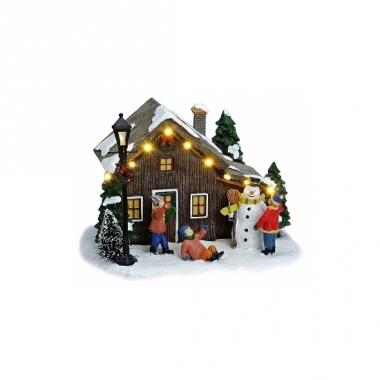 Verlichte kersthuisjes met sneeuwpop