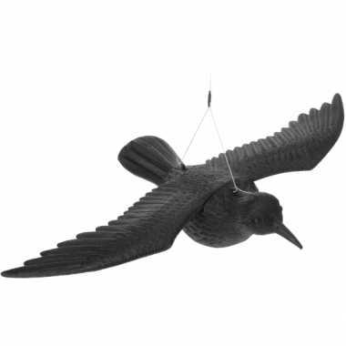 Vliegende vogelverschrikker kraai