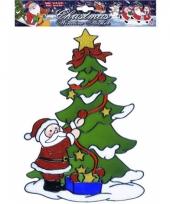 Kerst raamsticker kerstman bij kerstboom