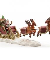 Kerstdorp figuurtjes kerstman in slee