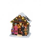 Verlichte kersthuisjes beren kraam